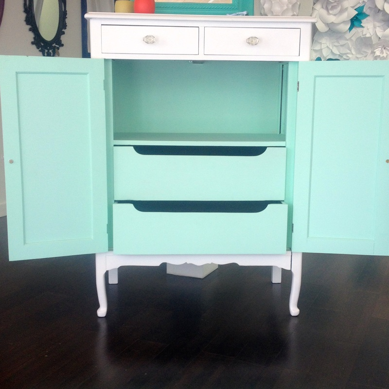 White cabinet with mint dresser