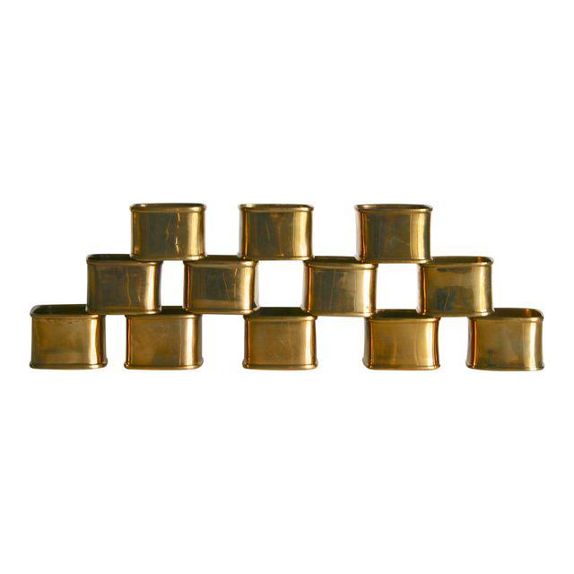 A set of 12 square vintage brass napkin rings. Great for any style table setting from traditional pull through design or fun bow style .  Have a nice patina but could also be polished to a shine shine. Made in India.