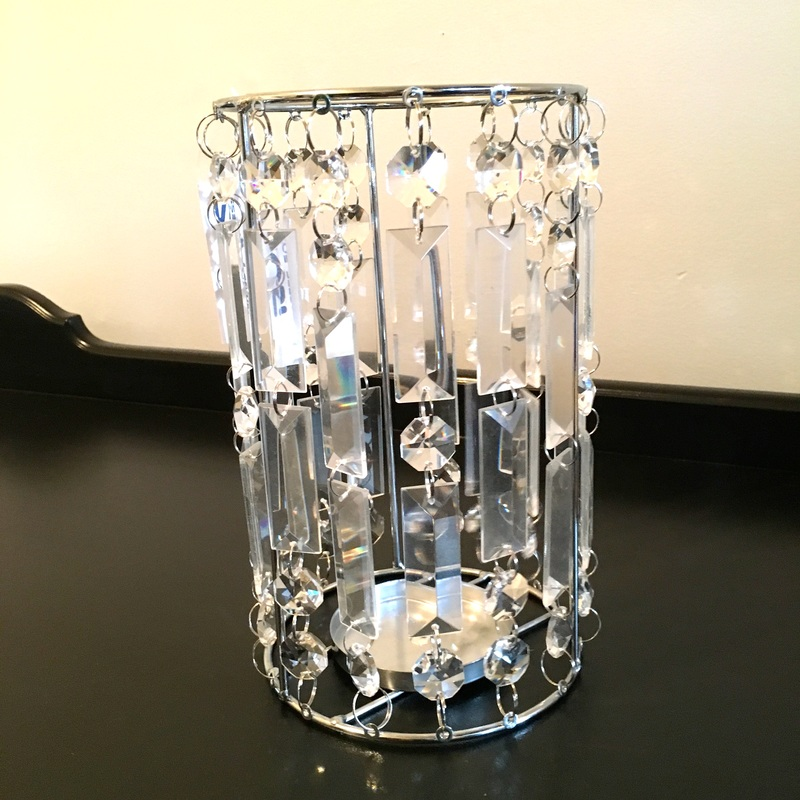 Candle holder transformed into lighting fixture