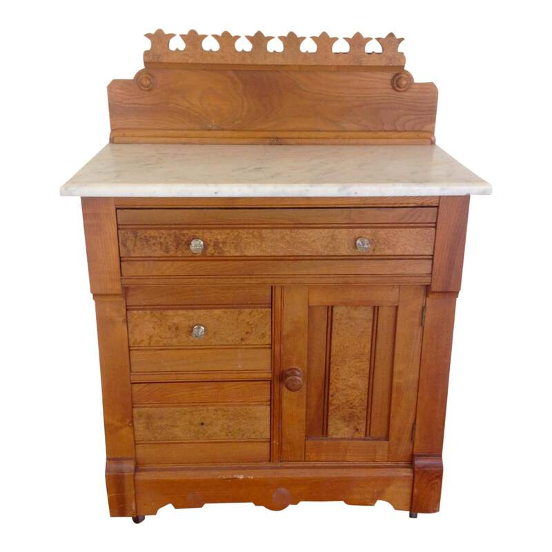 Antique G. Schindler & Co (Portland) wood cabinet with marble top, on caster wheels and burl crown detail. 3 drawers and a cabinet. Use in the kitchen, as a bathroom vanity or in a bedroom.