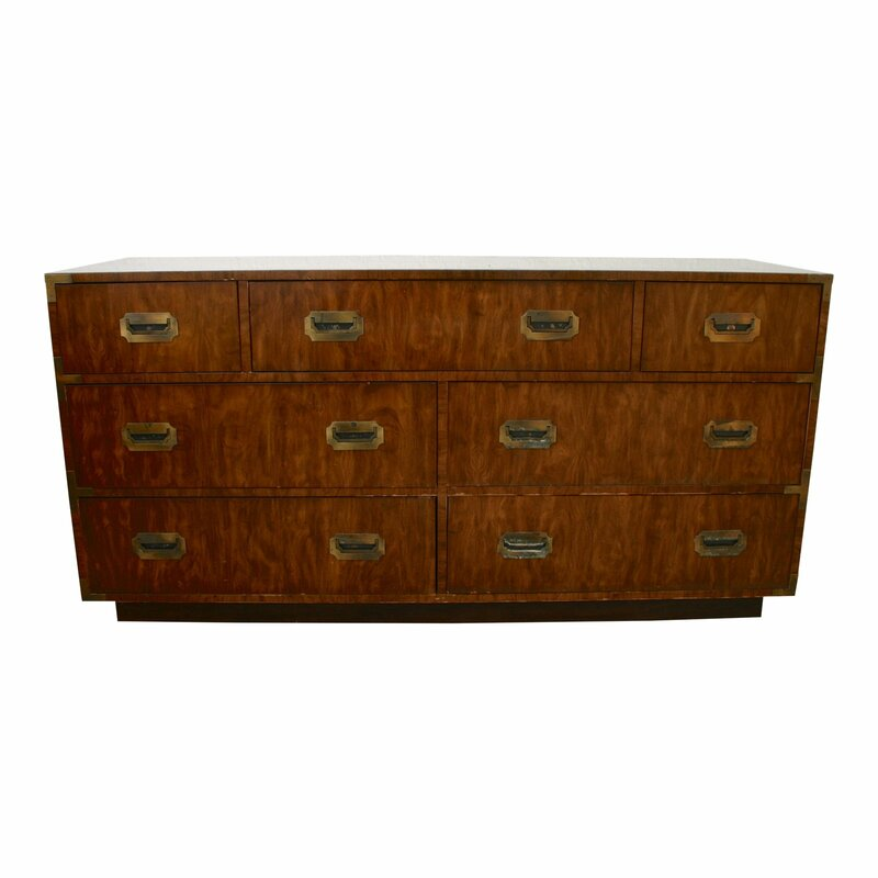 Campaign style lowboy dresser by Dixie Furniture Company. Seven dovetail drawers, original brass hardware and lovely wood grain. Beautiful as is or painted your favorite color! Drawer hardware has been polished and the brass corners have patina.