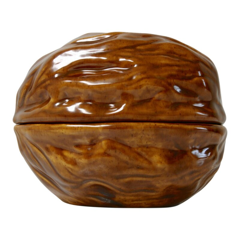 This whimsical lidded dish by Arnels is shaped like a walnut and the perfect quirky addition to your coffee table, bookshelf or entryway table. A fun place to store nuts, candies or trinkets! Dimensions: 6.25ʺW × 5.25ʺD × 5.25ʺH