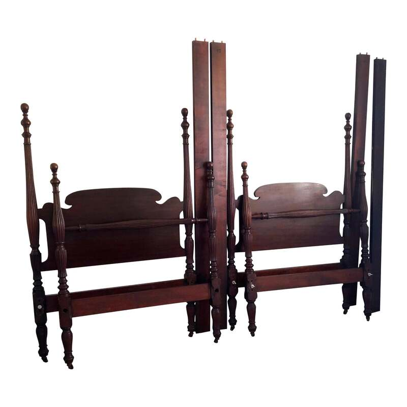 These early 20th-century set of mahogany Federal style carved twin beds are the perfect addition to any room! Excellent in a kids room, great for siblings or sleepovers, lovely in a guest room or fun in a bunk room at your weekend cottage! This pair of beds are very clean and includes two (2) headboards, two (2) footboards, and four (4)side rails. Beds are on casters and have beautifully carved blanket rails.