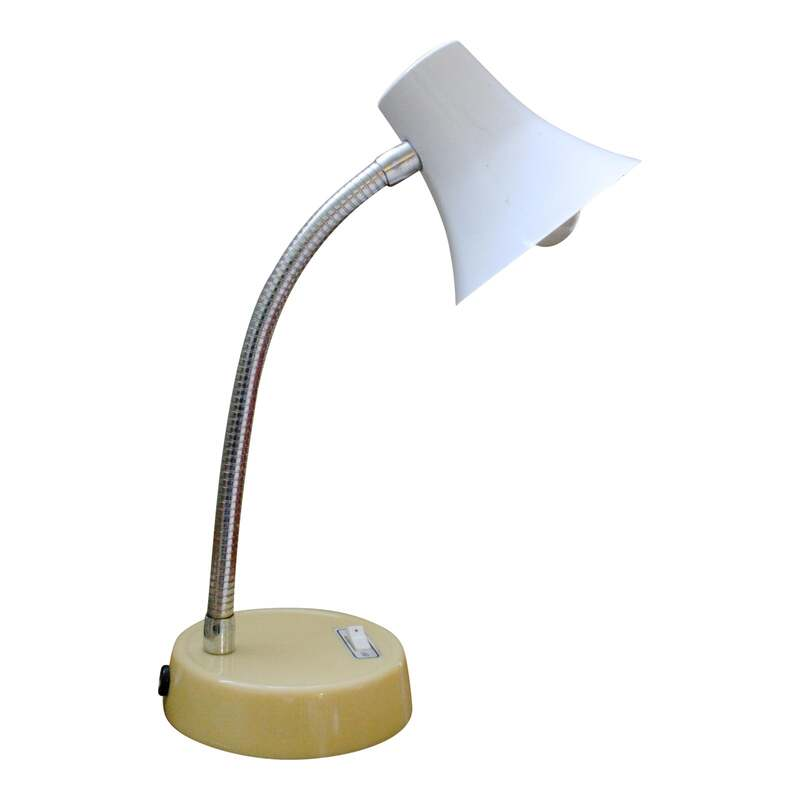 Super cool Vintage retro mod bendable neck table lamp with on/off switch on the base.The yellow base is plastic and the neck and white shade are metal. The original wiring is in good working Condition. Dimensions: 4ʺW × 4ʺD × 10.5ʺL