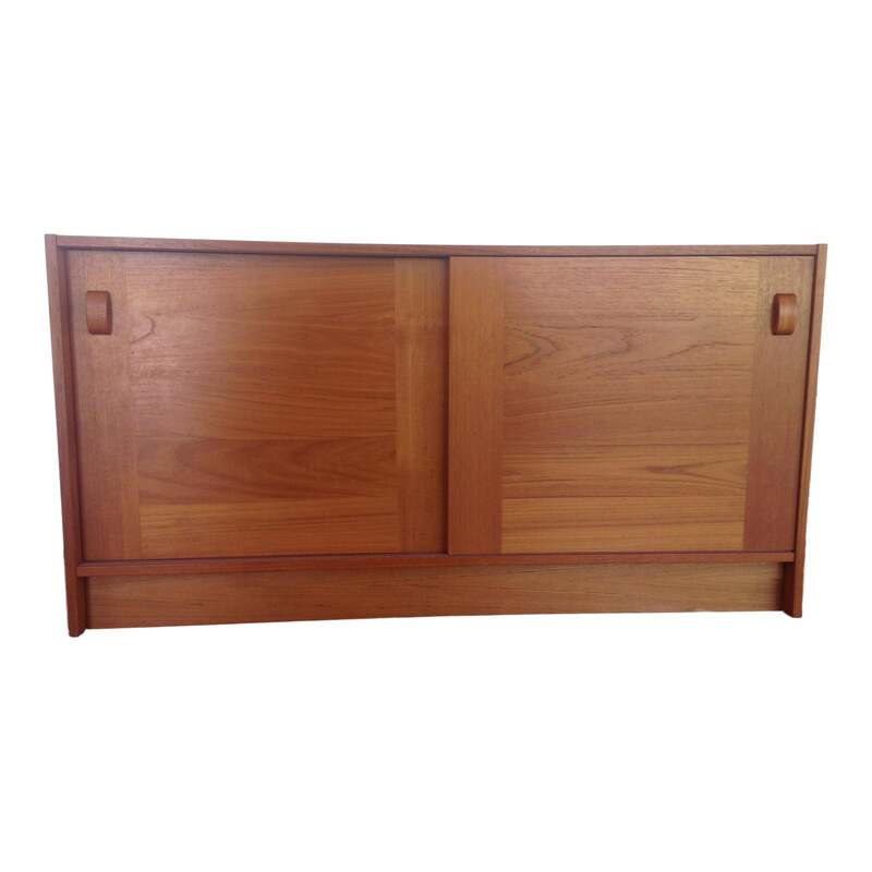 Vintage mid century modern Danish teak credenza/sideboard with 2 sliding doors and shelves by Domino Mobler of Denmark. This versatile piece would be great in a dining room, media room, office, kids room or nursery. Has manmade holes in back for TV cables.