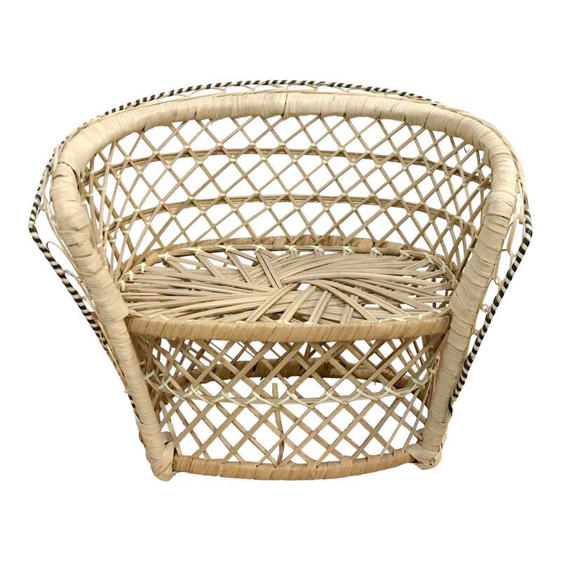 A delightful miniature Rattan Peacock Loveseat Chair. Just like the large scale chairs only smaller and perfect for plants or teddy bears! The rattan is accented with a black and white twist detailing around the edge. 9.5ʺW × 5.75ʺD × 8.5ʺH