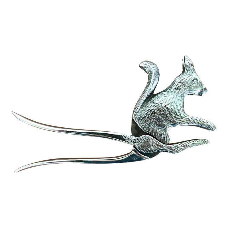 This silver squirrel nutcracker is a whimsical addition to your bar cart or atop some lovely coffee table books. Dimensions: 7.5ʺW × 0.5ʺD × 3.5ʺH